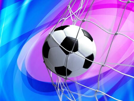 soccer ball in goal net on abstract background Stock Photo