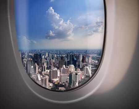 viewport: beautiful city view of Bangkok with blue sky from plane window