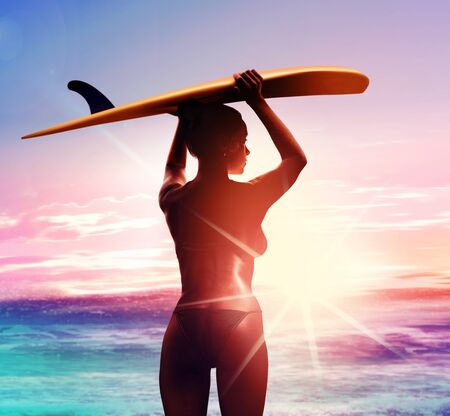 silhouette of surfer with surfboard on the beach at sunrise
