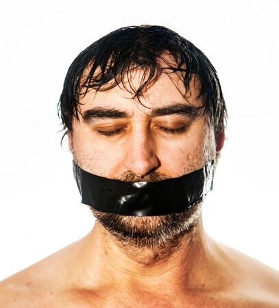 mans portrait with black  tape on his face Stock Photo