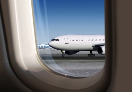 view of plane on runway through window, airport