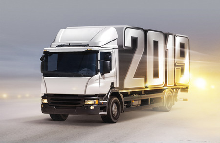 white truck with 2019 on ice road in blizzard