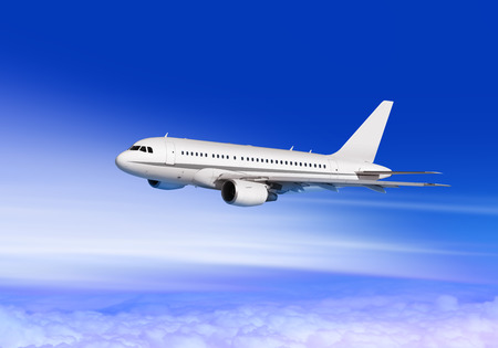 flying white passenger aircraft in cloud sky Stockfoto