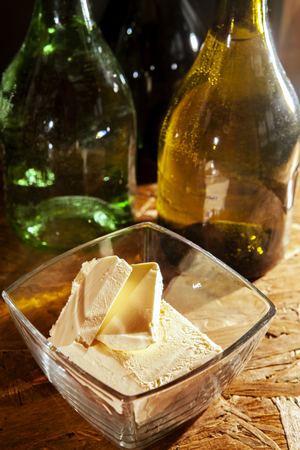 Butter in a plate and olive oil in bottles