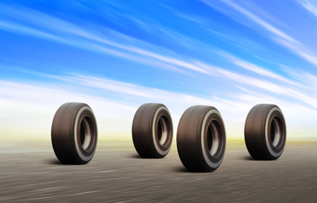 four black automobile wheels rush on the road with high speed Stockfoto