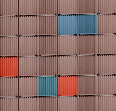 background of multi-colored freight shipping containers in a dock