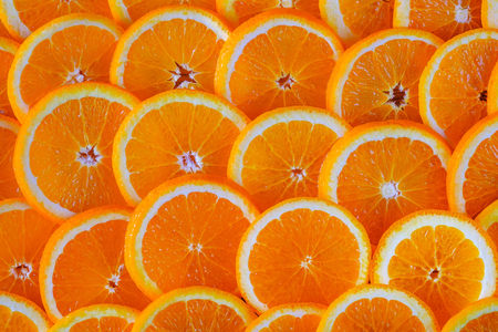 Seamless abstract background of fresh sliced oranges. Close-up view.