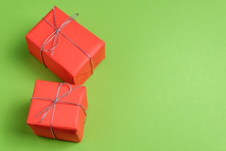 Two festive presents on green pastel background. 스톡 콘텐츠