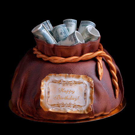 festive cake in shape of money bag with cash on top isolated on black background. Happy birthday congratulatory text