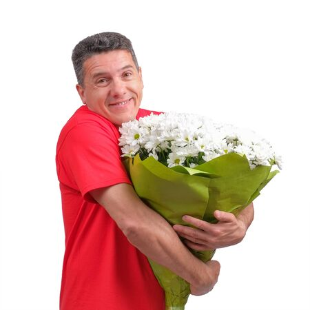 confused positive man wearing red informal t-shirt with bouquet in his hands Reklamní fotografie