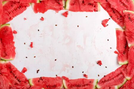 Frame of slices of fresh ripe watermelon as background. Top view, copy space