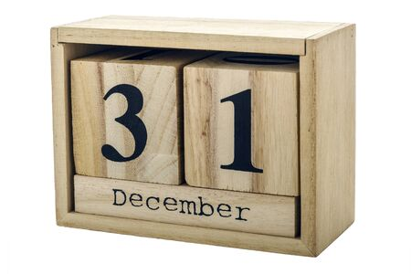 Planner wooden cube with numbers, 31 day of the month of December, winter isolated on white background. Stock fotó
