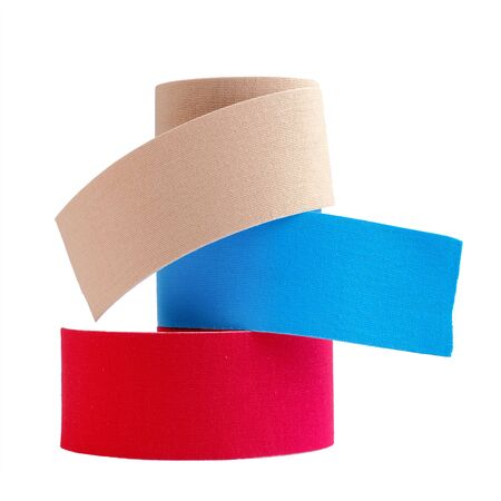 three rolls kinesiology tape for athletes isolated on white background. Kinesiology taping manipulate nerve receptors and reduces pain in muscles and speeds up the healing process