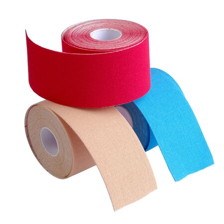 stack of three rolls kinesiology tape for athletes isolated on white background. Kinesiology taping manipulate nerve receptors and reduces pain in muscles and speeds up the healing process