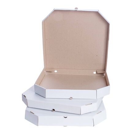 Close Up Stack Of Three Empty Different Size Carton Boxes For Pizza. Box on top is opened.