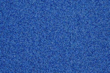 Blue background texture from marble chips. Plaster texture. Speckled colorful natural background.