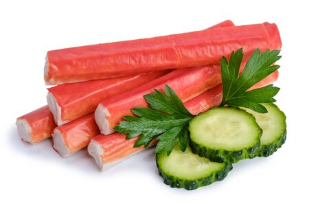 Pile of crab sticks, slices of cucumber and parsley leaf isolated on white background