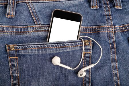 Mock up with smartphone and earphones in back jeans pocket. Blank space for your advertising or text on display. Close up view, vertical orientation Stock fotó
