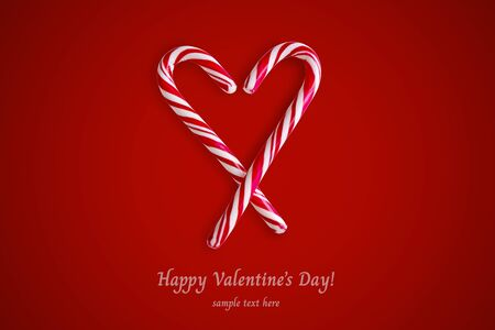 Two red and white candy canes in the shape of heart on a red background in center. Valentine's Day concept. Greeting card with copy space for your text or advertising, flat lay