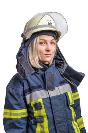 Portrait young brave girl firefighter in a fireproof uniform and helmet in her head looks at the camera. Isolated on white