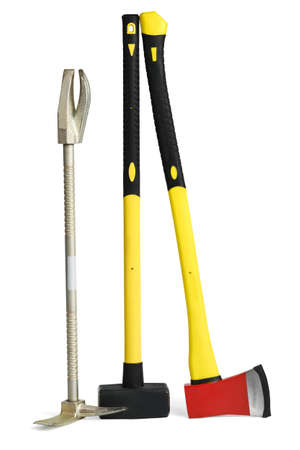 Large yellow sledgehammer, axe and hooligan forcible entry bar from firemans toolbox isolated on white background with clipping path Фото со стока