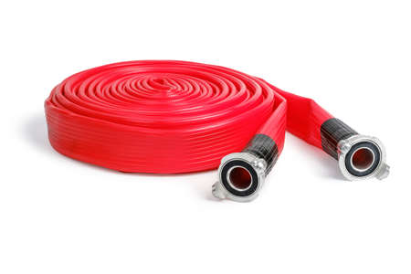 Rolled red firefighter hose isolated on the white background