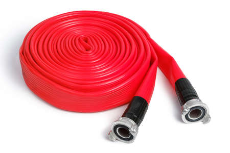 Rolled red fire hose isolated on the white background