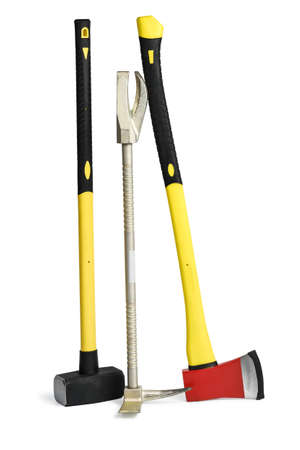 Large yellow sledgehammer, axe and hooligan forcible entry tool from firemans toolbox isolated on white background. Фото со стока
