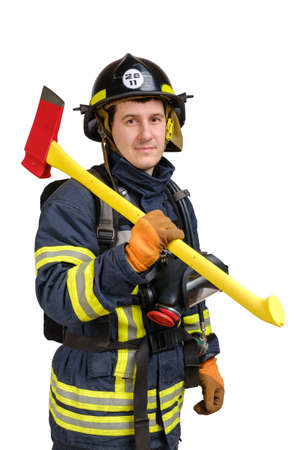 Portrait of young brave man in uniform and hard hat of fireman holds axe and looking at camera with smile isolated on white background