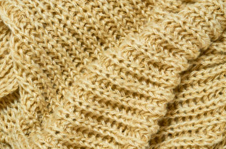 Close up view of wavy yellow woolen fabric as backdrop. Flat lay, copy space. High quality photo Imagens