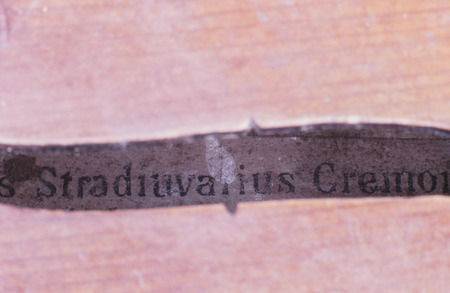 Retail of an old violin made by Stradivarius photo