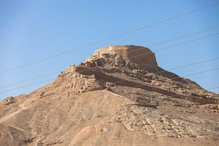 scavenging: tower of silence , Yazd, Zoroastrian tradition considered a dead body to be nasu, unclean. To preclude the pollution of earth or fire  the bodies of the dead are placed a top a dakhma and so exposed to the sun and to scavenging bird Stock Photo