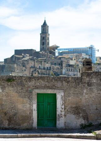 sassi: Matera, a green door at the entrance to the Sassi