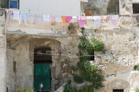 troglodyte: Matera in Italy with its troglodyte houses caratheristics Sassi Stock Photo
