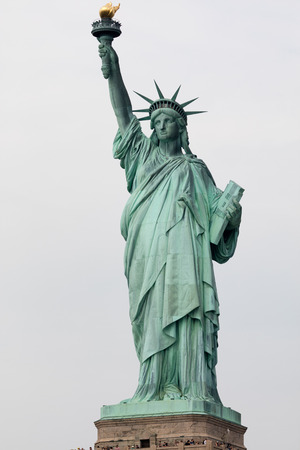 liberty torch: The Statue of Liberty is a colossal neoclassical sculpture on Liberty Island in New York Harbor in New York City, The copper statue, designed by Frédéric Auguste Bartholdi, a French sculptor, was built by Gustave Eiffel Stock Photo