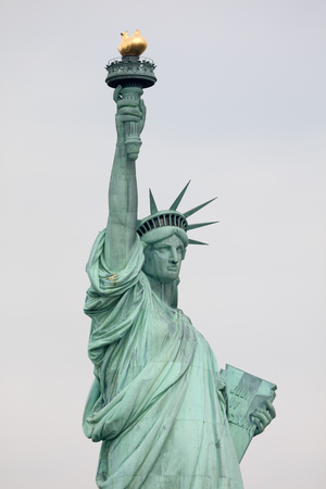 colossal: The Statue of Liberty is a colossal copper statue, designed by  Auguste Bartholdi, a French sculptor, was built by Gustave Eiffel Editorial