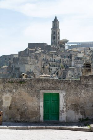 rupestrian: Matera, a green door at the entrance to the Sassi