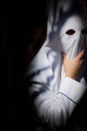 procession: Mask in easter procession, Svilla, Spain