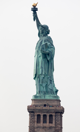 neoclassical: The Statue of Liberty is a colossal neoclassical sculpture on Liberty Island  in New York City