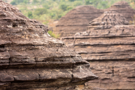 natural phenomenon: the Domes de Fabedougou  are natural phenomenon of rock sculpted by vwind and erosion in Burkina faso look like a stack of pancakes