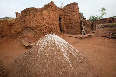 inhabit: Mud house and fetish in animist village in Burkina Faso