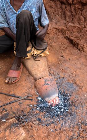 inhabit: Blacksmith in village of Burkina Faso, Africa Stock Photo