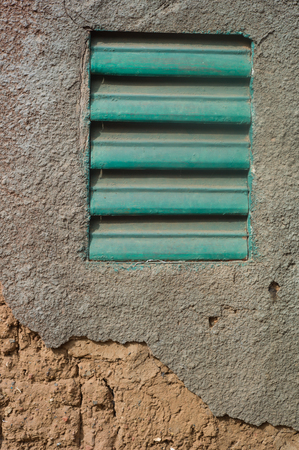mud house: A shutter in mud house of village in Burkina Faso Stock Photo