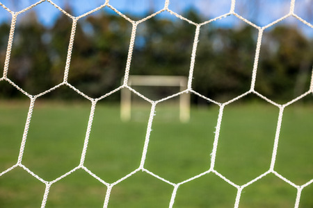 opposing views: Soccer net with views of the opposing goal Stock Photo