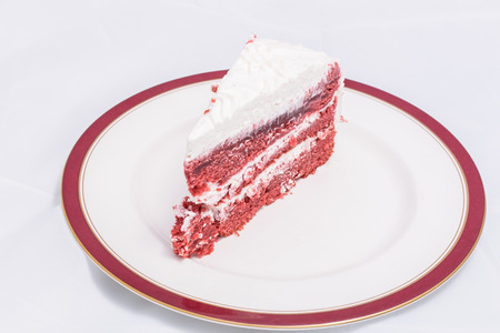 sharply: Red velvet cake is very dramatic looking with its bright red color sharply contrasted by a white cream