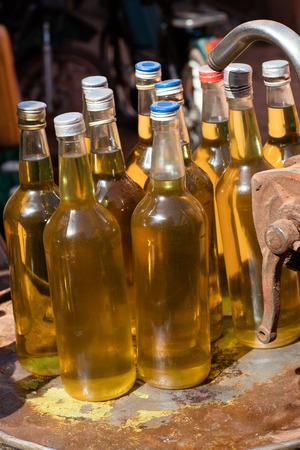 red palm oil: Palm oil bottles in market, Burkina Faso