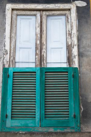 Napoli: A typical green neapolitan window, Napoli, Italy