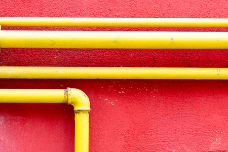 inoperative: yellow gas pipe on a pompeian red wall