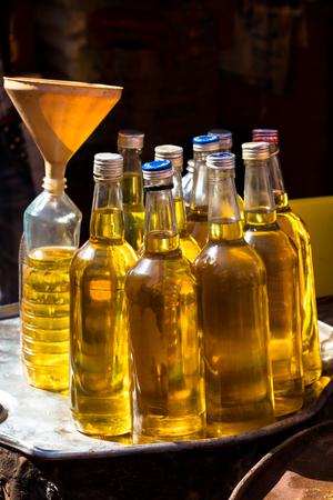 liquid state: Palm oil bottles in market, Burkina Faso