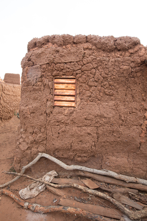 inhabit: mud house in caratheristic village in Burkina Faso